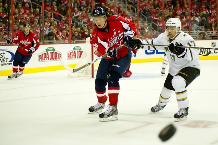Alexander Semin (28) of the Washington Capitals passes the puck away from Toby Petersen (17) of the Dallas Stars during the second period at the Verizon Center in Washington on Tuesday, Nov. 8, 2011. (Andrew Harnik/The Washington Times)