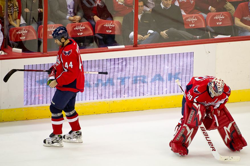 Roman Hmrlik (44) and goalie Michael Neuvirth (30) of the Washington Capitals stand near the bench on a time out while losing to the Dallas Stars 5-2 late in the 3rd period at the Verizon Center in Washington, DC. Tuesday, November 8, 2011. (Andrew Harnik / The Washington Times)