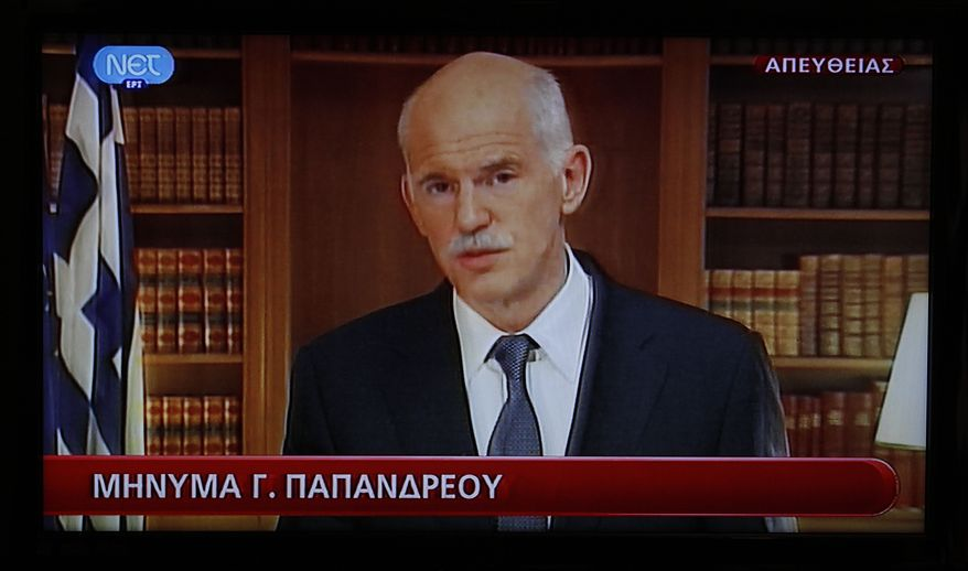 Greek Prime Minister George Papandreou announces on Wednesday, Nov. 9, 2011, that a agreement has been reached on forming interim government in this image taken from a television broadcast. (AP Photo/Dimitri Messinis)