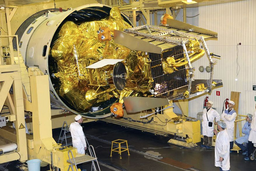 ** FILE ** Russian space engineers prepare the unmanned Phobos-Grunt probe for launch at the Baikonur Cosmodrome in Kazakhstan on Wednesday, Nov. 2, 2011. (AP photo/Russian Roscosmoc space agency)