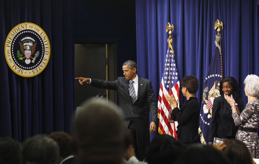 President Barack Obama makes an unscheduled visit to the African American Policy in Action Leadership Conference, Wednesday, Nov. 9, 2011, in the Eisenhower Executive Office Building on the White House campus in Washington. (AP Photo/Charles Dharapak)