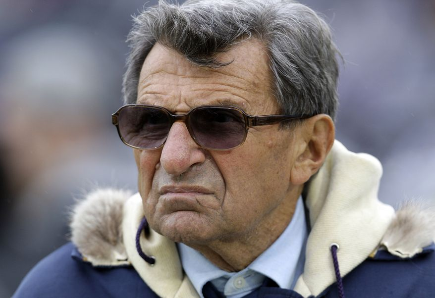Penn State coach Joe Paterno has been fired by the university's board of trustees. (AP Photo/Carolyn Kaster, File)