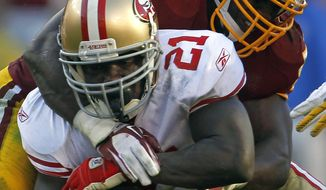 San Francisco 49ers running back Frank Gore (21) tries to break free from Washington Redskins inside linebacker London Fletcher while rushing the ball in the first half of an NFL football game in Landover, Md., Sunday, Nov. 6, 2011. (AP Photo/Pablo Martinez Monsivais)