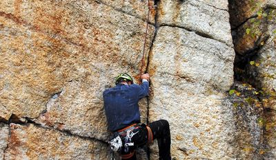 Peter Keane, a board member of the American Mountain Guides Association, tackles a cliff during the association's annual conference, where many of the top guides in the United States worked on a range of skills. (Ascent Services Worldwide LLC via Associated Press)