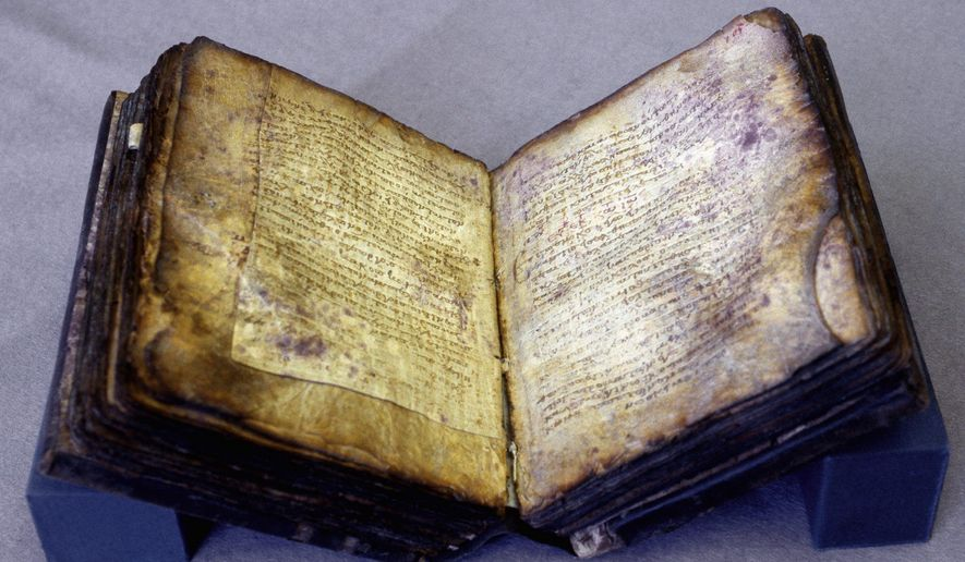 The Archimedes Palimpsest - the oldest manuscript containing work attributed to the Greek mathematician Archimedes - is owned by a private Washington collector who paid $2 million for it at Christies.(The Walters Art Museum)