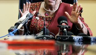 ** FILE ** Newly re-elected Liberian President Ellen Johnson-Sirleaf answers questions as she meets with members of the press in Liberia's capital on Thursday, Nov. 10, 2011. (Associated Press)