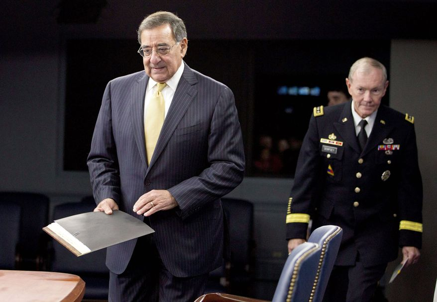 Defense Secretary Leon E. Panetta and Joint Chiefs Chairman Gen. Martin Dempsey arrive for a news conference at the Pentagon on Thursday. Mr. Panetta ordered new reviews into mismanagement at the military's national mortuary in Delaware. (Associated Press)