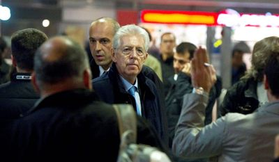 "Senator Mario Monti, waiting for his wife at Rome's Termini station Thursday, is widely considered to be the top choice for the Italian premiership, now that Silvio Berlusconi has pledged to resign soon. Mr. Monti met with President Giorgio Napolitano on Thursday night in what his office described as a ""courtesy visit."" (Associated Press)"