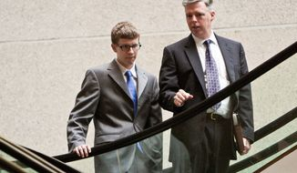 Kevin Coffay, 20, enters Montgomery County Circuit Court with his attorney, Michael McAuliffe, before pleading guilty to three counts of manslaughter that could land him up to 40 years in prison. (T.J. Kirkpatrick/The Washington Times)