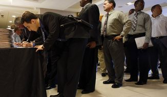 An Opportunity Expo held Thursday in Miami by RecruitMilitary attracts lines of veterans seeking jobs and educational and business-ownership opportunities. The Senate on Thursday passed a bill promoting hiring veterans. (Associated Press)