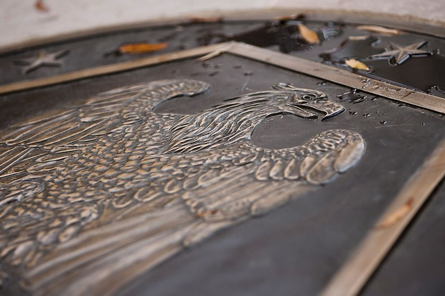 A bronze plaque was specially recreated to replace a missing plaque at the center of the District of Columbia WWI Memorial as part of the memorial's renovation, seen during a rededication ceremony in Washington, D.C. on Nov. 10, 2011. The National Park Service did not have records of the exact design on the original plaque, with the exception of the design including an image of an eagle, but made the replacement to mesh with the marble patterns on the floor.(T.J. Kirkpatrick/ The Washington Times)