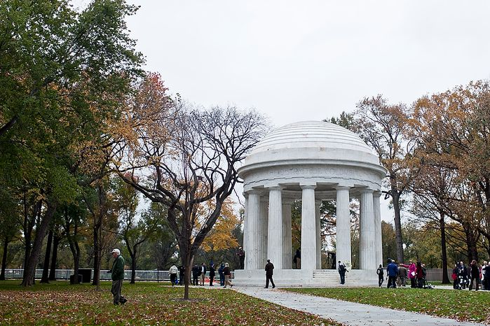 Pedestrians, veterans and members of the media walk around the grounds of the newly renovated District of Columbia WWI Memorial after a rededication ceremony in Washington, D.C. on Nov. 10, 2011.(T.J. Kirkpatrick/ The Washington Times)