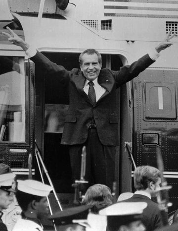** FILE ** In this Aug. 9, 1974, file photo, Richard Nixon says goodbye to members of his staff outside the White House in Washington as he boards a helicopter for Andrews Air Force Base after resigning the presidency in Washington. (AP Photo/File)