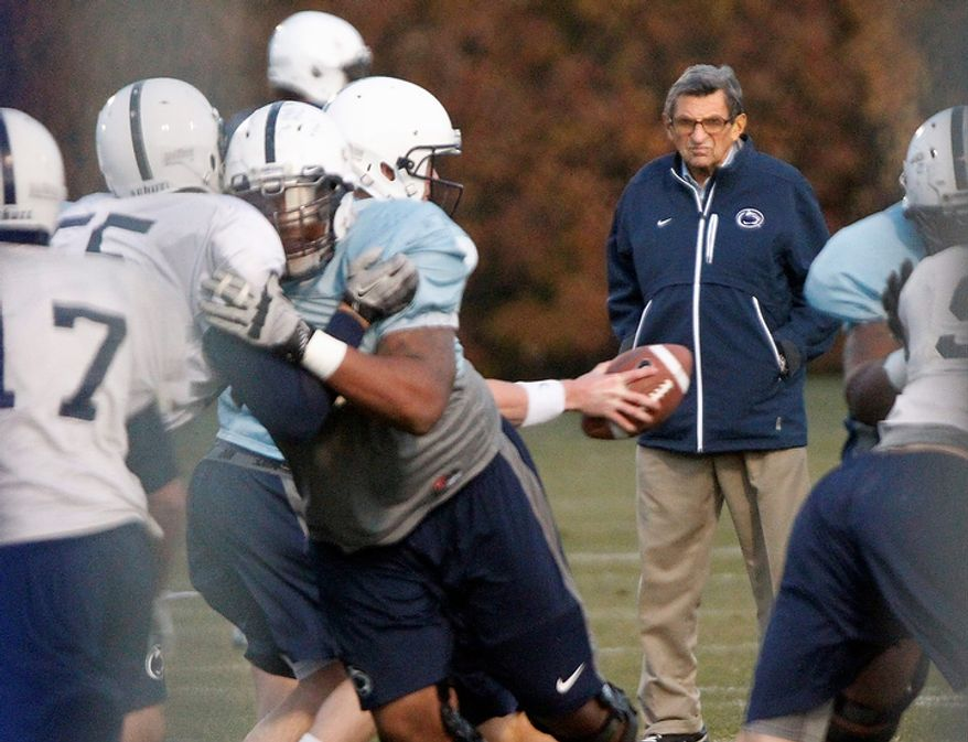 Penn State coach Joe Paterno watches his football team practice on Wednesday, Nov. 9, 2011, in State College, Pa. Paterno, who preached success with honor for a half-century but whose legend was shattered by a child-sex-abuse scandal, said Wednesday that he would retire at the end of the season. (AP Photo/Matt Rourke)