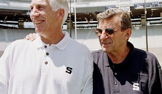 ** FILE ** Penn State head football coach Joe Paterno (right) poses on Aug. 6, 1999, with his defensive coordinator, Jerry Sandusky, during Penn State Media Day at State College, Pa. (Associated Press)