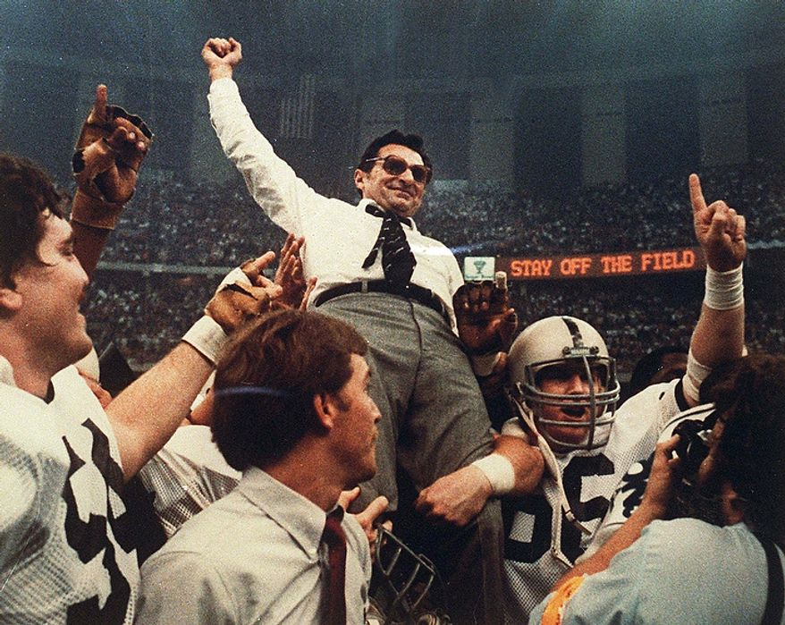 ** FILE ** Penn State football coach Joe Paterno is carried off the field after a 27-23 victory against Georgia in the Sugar Bowl to claim the national championship at the Superdome in New Orleans on Jan. 2, 1983. (AP Photo/File)