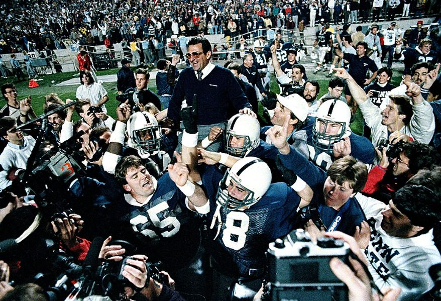 In this Jan. 2, 1987 file photo, Penn State coach Joe Paterno is carried after defeating Miami, 14-10,  in the Fiesta Bowl, to win the national championship, in Tempe, Ariz. Paterno say he plans to retire at the end of the season, his long and illustrious career brought down because he failed to do all he could about an allegation of child sex abuse against a former assistant. (AP Photo/Jim Gerberich, File)