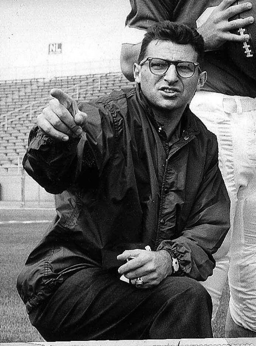 In this Jan. 28, 1965, file photo, former Penn State associate football coach Joe Paterno directs players at State College, Pa. Penn State trustees fired head football coach Joe Paterno and university president Graham Spanier amid the growing furor over how the school handled sex abuse allegations against an assistant coach, Wednesday, Nov. 9, 2011. (AP Photo, File)