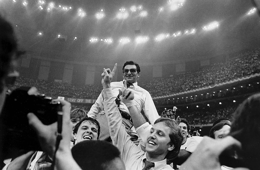 In this Jan. 1, 1983 file photo, Penn State head football coach Joe Paterno takes a victory ride from his players on the field at the Superdome after winning the Sugar Bowl and national championship in New Orleans. Penn State football coach Joe Paterno say he plans to retire at the end of the season, his long and illustrious career brought down because he failed to do all he could about an allegation of child sex abuse against a former assistant. (AP Photo/File)