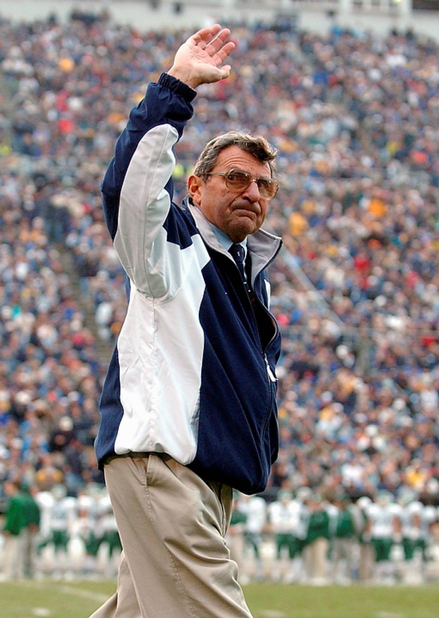 In this Nov. 20, 2004, file photo, Penn State coach Joe Paterno waves to the crowd in the fourth quarter of Penn State's 37-13 win over Michigan State in an NCAA college football game in State College, Pa. Penn State trustees fired Paterno and university president Graham Spanier amid the growing furor over how the school handled sex abuse allegations against an assistant coach. The massive shakeup Wednesday night, Nov. 9, 2011, came hours after Paterno announced that he planned to retire at the end of his 46th season. (AP Photo/Carolyn Kaster, File)