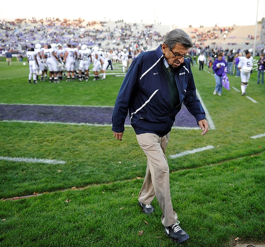 In this file photo taken Oct. 22, 2011, Penn State coach Joe Paterno walks off the field after warmups before Penn State's NCAA college football game against Northwestern in Evanston, Ill. Penn State administrators canceled Paterno's weekly news conference Tuesday Nov. 8, 2011 in which he was expected to field questions about a sex abuse scandal involving a former assistant coach. Paterno's son Scott tells The Associated Press that the decision was made by president Graham Spanier's office. (AP Photo/Jim Prisching, File)