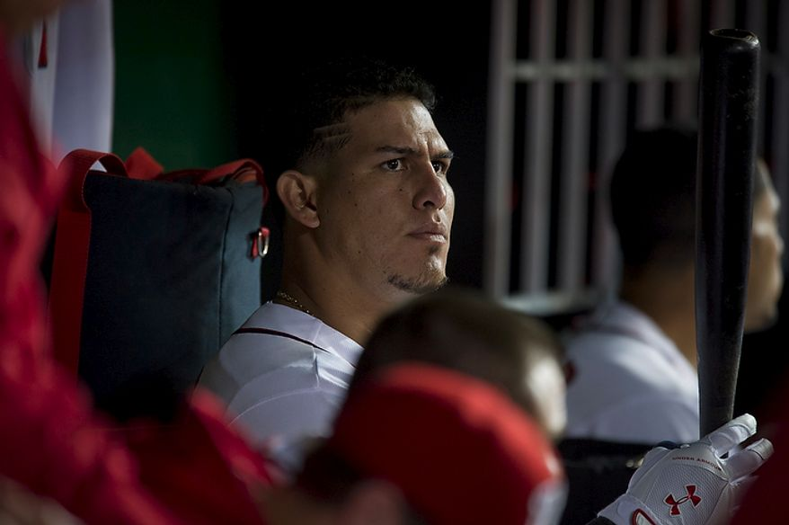 Washington Nationals catcher Wilson Ramos waits for his turn at bat in the dugout in the bottom of the eighth inning as the Nationals host the Los Angeles Dodgers at Nationals Park in Washington on Tuesday, Sept. 6, 2011. Ramos' mother, Maria Campos, and his younger sister, Milanyela Ramos, from Valencia, Venezuela, were granted visas to visit him and to watch him for the first time in the major leagues. (Rod Lamkey Jr./The Washington Times)