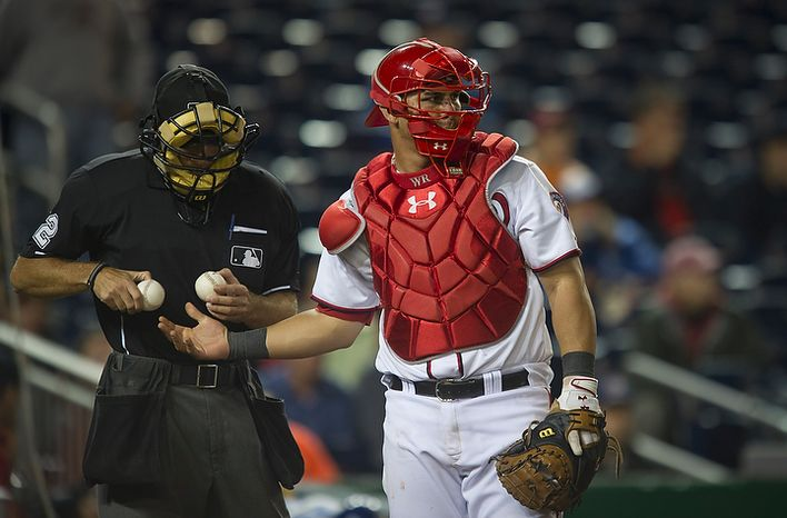 Washington Nationals catcher Wilson Ramos gets a fresh baseball from home plate umpire James Hoye in the top of the ninth inning as the Nationals host the Los Angeles Dodgers at Nationals Park in Washington, DC, Tuesday, September 6, 2011. His mother, Maria Campos and his younger sister, Wilson's sister Milanyela Ramos from Valencia, Venezuela, were recently granted visas to visit him and to watch him for the first time play in the major leagues. (Rod Lamkey Jr./The Washington Times)