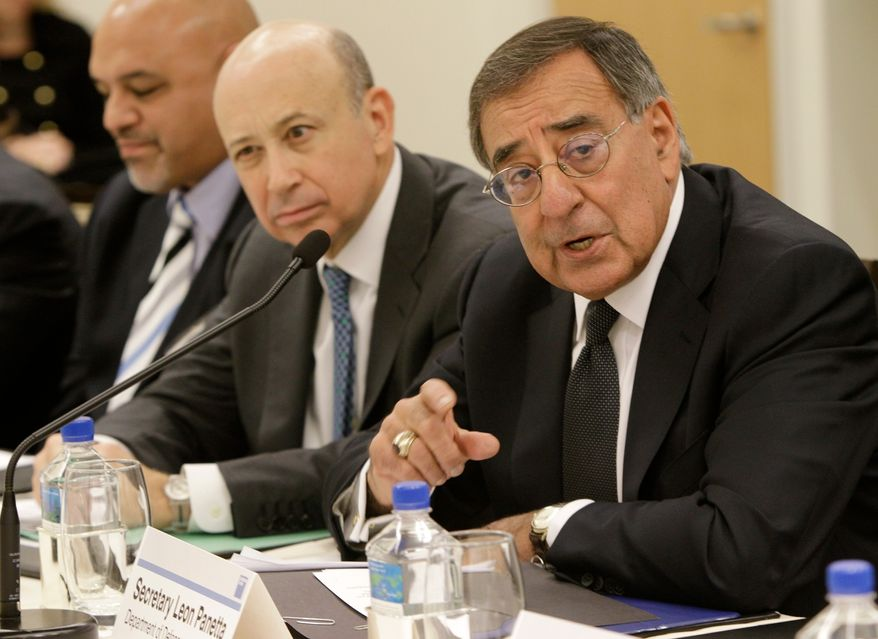** FILE ** Secretary of Defense Leon Panetta, right, addresses a group of CEOs, including Goldman Sachs Chairman and CEO Lloyd Blankfein, center, during a meeting about hiring veterans hosted by the Goldman Sachs Foundation at the company's headquarters in New York, Monday, Nov. 7, 2011. (AP Photo/Kathy Willens)