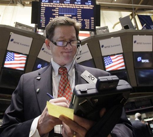 In this Nov. 10, 2011 photo, trader Christopher Forbes works on the floor of the New York Stock Exchange. The prospect of new governments in Greece and Italy helped support market sentiment Friday, Nov. 11, 2011, at the end of a hugely-volatile week when investors fretted over the future of the euro currency and the outlook for the global economy. (AP Photo/Richard Drew)