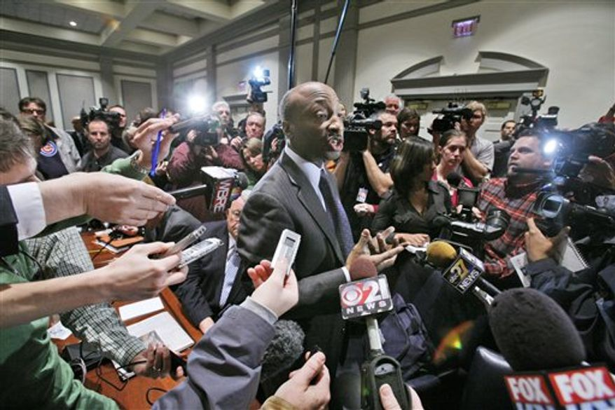Penn State University Board of Trustees member Kenneth C. Frazier, President of Merck & Co., is surrounded by media after being appointed by the trustees to chair a special committee to investigate the alleged child abuse on campus, in State College, Pa., Friday, Nov. 11, 2011. The Penn State University Board of Trustees who fired legendary football coach Joe Paterno and school president Graham Spanier are meeting in the wake of the massive shakeup prompted by a child sex-abuse scandal.(AP Photo/Gene J. Puskar)