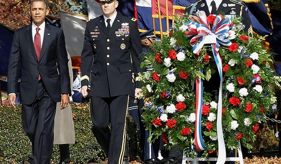 President Barack Obama walks in with Maj. Gen. Michael S. Linnington, Commander of the U.S. Army Military District of Washington, before placing a wreath at the Tomb of the Unknowns during a Veteranís Day ceremony at Arlington National Cemetery in Arlington, Va., Friday, Nov. 11, 2011. (AP Photo/Pablo Martinez Monsivais)