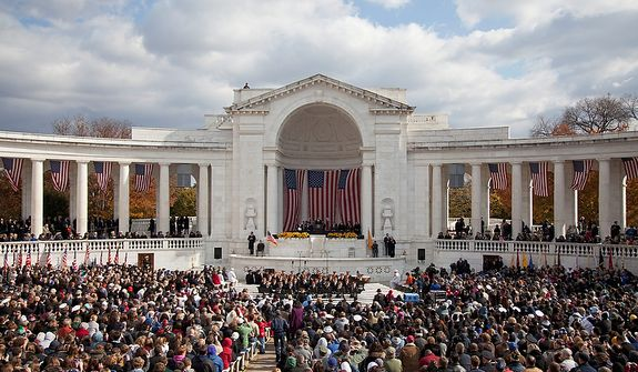 President Barack Obama speaks during a Veterans Day ceremony at Arlington National Cemetery in Arlington, Va., Friday, Nov. 11, 2011.  (AP Photo/Evan Vucci)