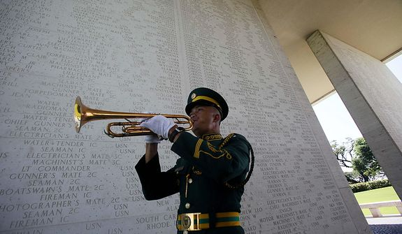 Philippine army Pfc. Enrico Disimulacion plays the Taps during wreath-laying ceremony at the American Cemetery and Memorial at suburban Taguig city, east of Manila, Philippines, to pay tribute to U.S. veterans and their families on Veterans Day Friday, Nov. 11, 2011. The Manila American Cemetery and Memorial contains the remains of WWII Americans who died in the Pacific, China, India, and Burma along with Philippine Scouts who served with the U.S. forces. (AP Photo/Bullit Marquez)