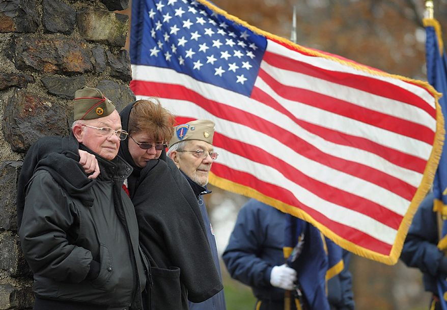 From left,  World War II veteran Angelo Basso, of Palmer Township, Pa. granddaughter Tammie Kelshaw, of Northampton, and brother World War II veteran Jack Basso, of Palmer Township, stand and listen during a Veterans Day ceremony at Upper Hackett Park in Easton, Pa on  Friday, Nov. 11, 2011.   (AP Photo/The Express-Times, Matt Smith)