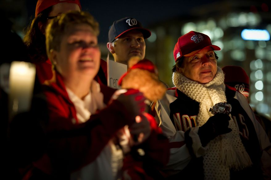 Olga Stopher (right) joins other Nationals fans during a candlelight vigil for Nationals' rookie catcher Wilson Ramos at Nationals Park in Washington, DC, Friday, November 11, 2011. Ramos was kidnapped by armed gunmen in front of his family home in Venezuela on Wednesday night.(Rod Lamkey Jr. / The Washington Times)