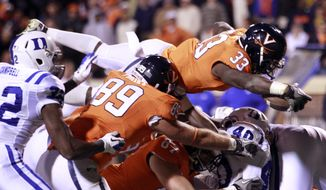 Virginia running back Perry Jones dives into the end zone for a touchdown against Duke in the third quarter on Saturday, Nov. 12, 2011, Charlottesville, Va. Virginia won 31-21. (AP Photo/Andrew Shurtleff)