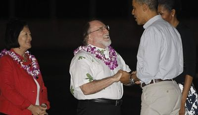 President Barack Obama and first lady Michelle Obama are welcomed by Hawaii Gov. Neil Abercrombie, center, and Rep. Mazie Hirono as they disembark Air Force One as they arrive at Hickam Air Force Base in Honolulu, Hawaii, where they will host the APEC summit, Friday, Nov. 11, 2011. (AP Photo/Charles Dharapak)