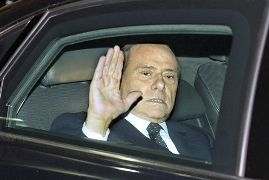 Italian Premier Silvio Berlusconi leaves the Quirinale Presidential Palace after meeting Italian President Giorgio Napolitano, in Rome, Saturday, Nov.12, 2011. Berlusconi resigned after the Parliament's lower chamber passed European-demanded reforms, ending a 17-year political era and setting in motion a transition aimed at bringing Italy back from the brink of economic crisis. (AP Photo / Roberto Monaldo)