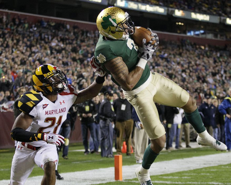 Notre Dame wide receiver Michael Floyd, right, makes a touchdown catch in front of Maryland defensive back Trenton Hughes in the first half of an NCAA college football game in Landover, Md., Saturday, Nov. 12, 2011. (AP Photo/Patrick Semansky)