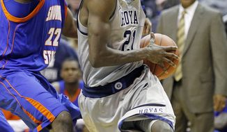 Georgetown's Jason Clark (21) drives toward the basket past Savannah State's Rashad Hassan during the first half of an NCAA college basketball game, Saturday, Nov. 12, 2011, in Washington. (AP Photo/Haraz Ghanbari)