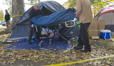 A body is removed from a tent in the Occupy Salt Lake camp in Pioneer Park, Friday Nov. 11, 2011, in Salt Lake City. (AP Photo/The Salt Lake Tribune, Al Hartmann)