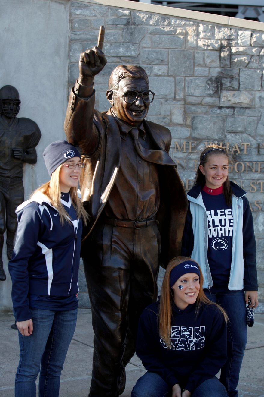 The statue of Joe Paterno outside Beaver Stadium remains a popular attraction on Penn State's campus. Fans expressed views in support of the college football coaching icon and in support of the victims of the child sexual abuse that allegedly occurred under Paterno's watch. (Associated Press)