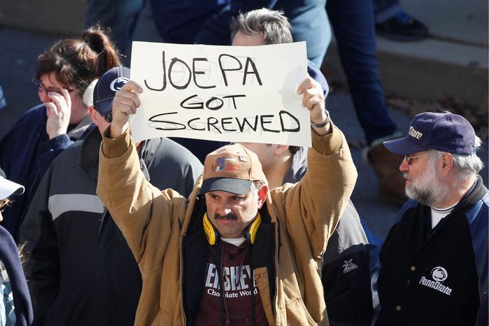 A man displays a sign before an NCAA college football game between Nebraska and Penn State Saturday, Nov. 12, 2011, in State College, Pa. (AP Photo/Matt Rourke)