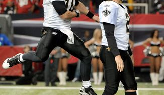 New Orleans' Chase Daniel reacts after John Kasay's fourth field goal, a 26-yarder in overtime, gave the Saints a a 26-23 win over the Atlanta Falcons in a key NFC South matchup. (Associated Press)
