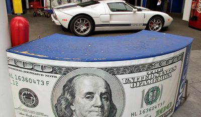 The Galpin Motors of North Hills car dealership has stayed in Los Angeles, but many dealers have been driven away from the city by its hefty business taxes. (Associated Press)