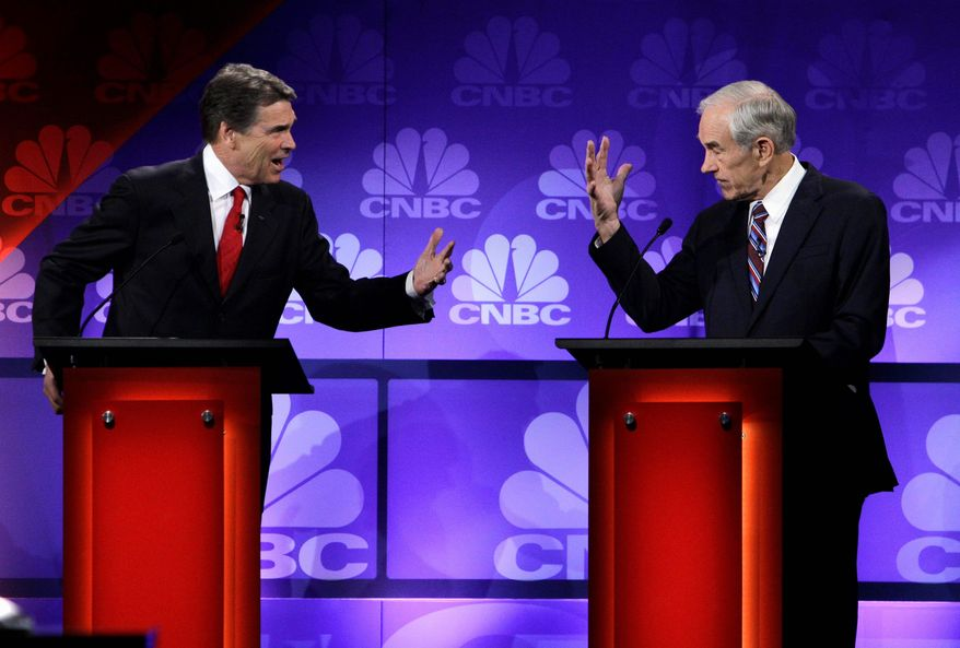 Rep. Ron Paul said he wasn't tring to embarrass fellow Texan Rick Perry when Mr. Perry forgot, during a debate on Wednesday, one of the three federal agencies he wants to abolish if he's elected president. Mr. Paul held up five fingers. (Associated Press)