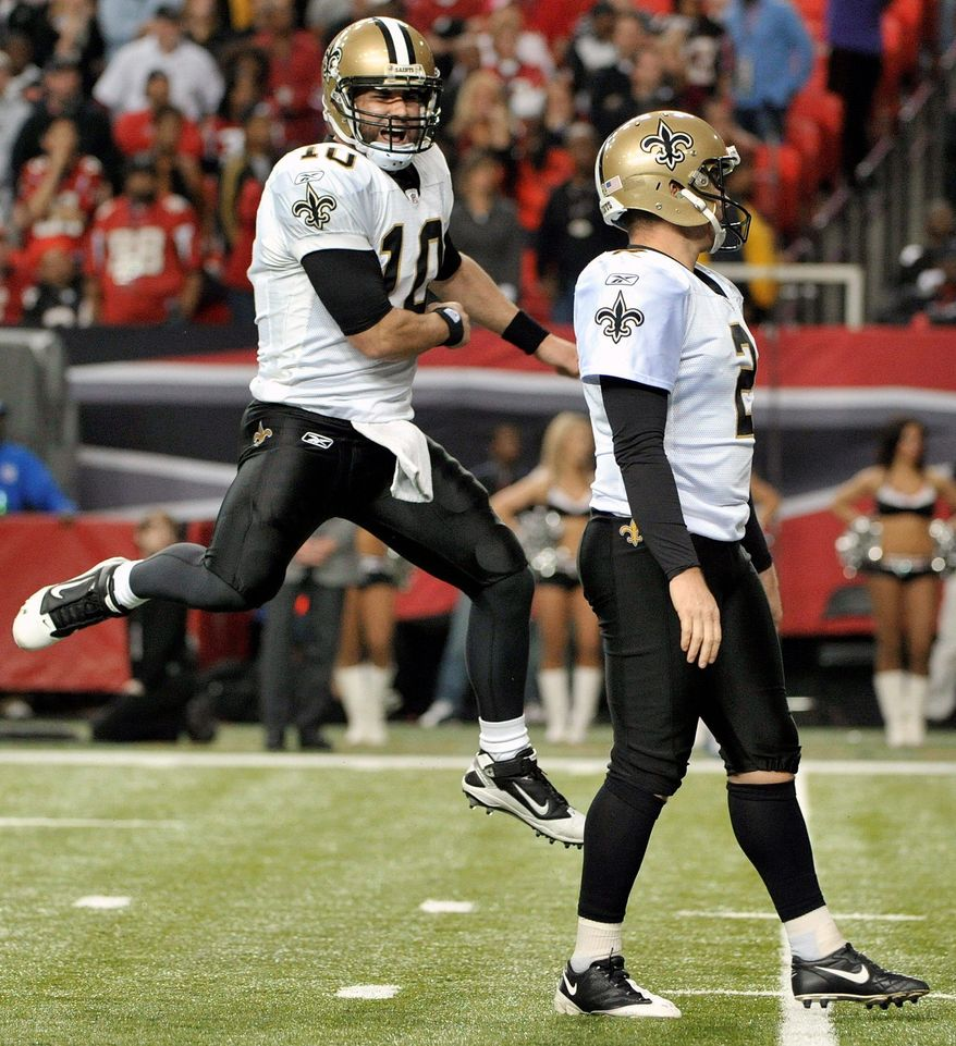 New Orleans' Chase Daniel (10) rcelebrates after John Kasay's fourth field goal, a 26-yarder in overtime, gave the Saints a a 26-23 win over the Atlanta Falcons in a key NFC South matchup Sunday. (Associated Press)