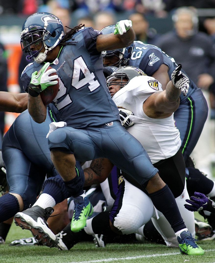 Seahawks running back Marshawn Lynch compiled 167 total yards and his team's only touchdown Sunday as Seattle upset Baltimore at home. (Associated Press)