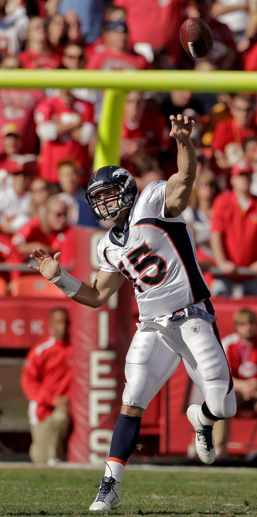 Denver Broncos quarterback Tim Tebow (15) passes the ball during the first half of an NFL football game against the Kansas City Chiefs, Sunday, Nov. 13, 2011, in Kansas City, Mo. (AP Photo/Charlie Riedel)