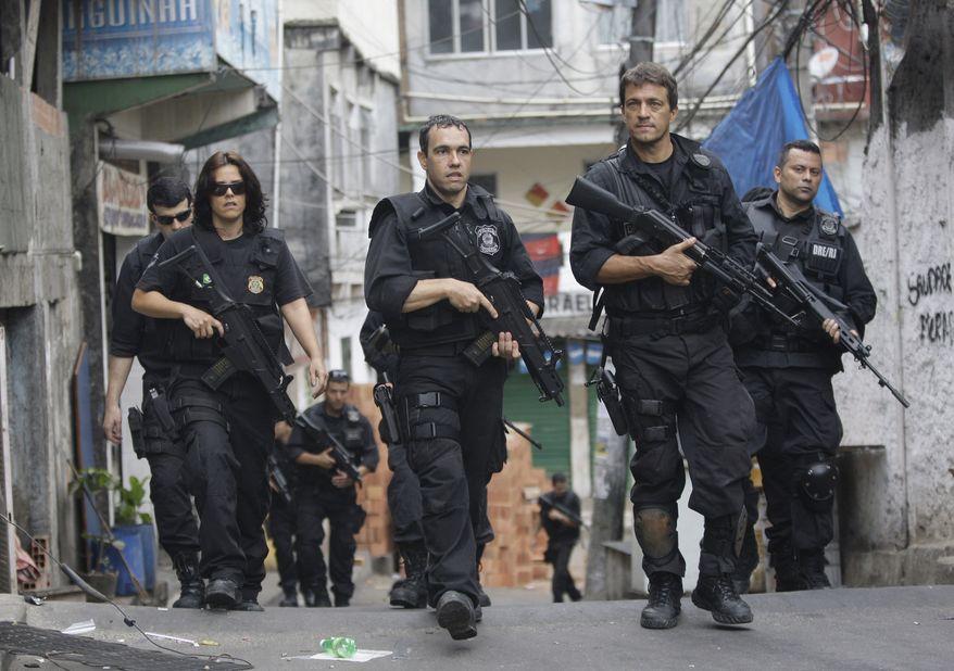 Brazil's policemen guard the streets of the Rocinha slum in Rio de Janeiro on Nov.13, 2011. (Associated Press)